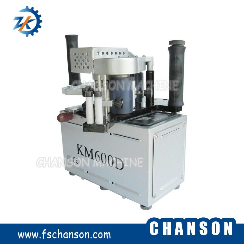 Anillador borde portable KM600D
