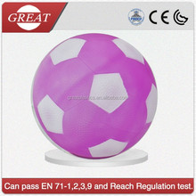 Inflatable pvc neon pink soccer ball in toys on the beach