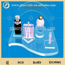 Hot sale small acrylic skin care display stand cosmetic rack make up shelf