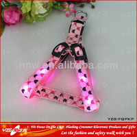 Pink LED adjustable dog harness with beautiful heart-shaped print on webbing