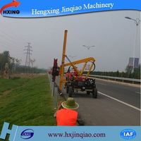 Highway guardrail installing piling and extracting mini pile driver