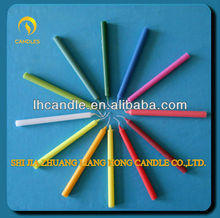 Small and thin colorful paraffin wax candle for birthday