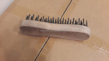 Black wire wooden cleaning brush