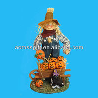 boy with resin halloween decoration pumpkins