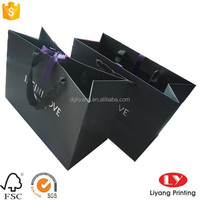 black high end Paper Shopping Bags with ribbon handle and silver logo supplier