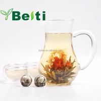 Beautiful blooming flower tea made of green tea and flower EU standard