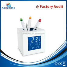 Home or office digital alarm clock with penholder