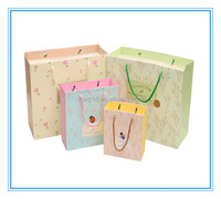 2015 hot sale customized holiday christmas kraft paper bag,gift paper bag,paper gift bag