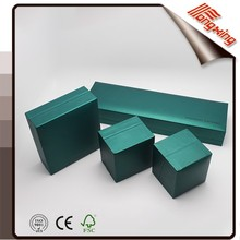 green leather-like paper box with satin and velvet insert