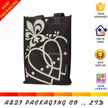 2015 hottest durable metallic button sewing black cloth carrying bag for packaging jeans