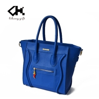 Hot sale quality smiling face pattern women tote bag brand