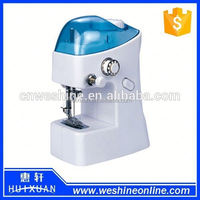 Mini Hand-Held Clothes Sewing Machine