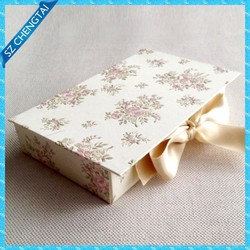 Flower embossed book shape customized packaging wedding favor box