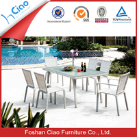 White plastic rattan outdoor furniture dining table and chair with glass top