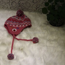 knitting hat with ball top, winter hat with two strings on side