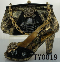 New design black high heeled shoes and matching bags for party dress
