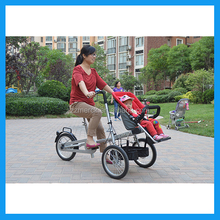 mother riding baby stroller bicycle