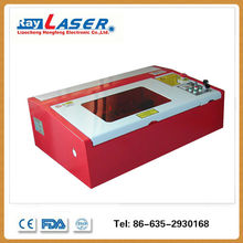 table top silicone wristband laser cutting and engraving machine for glass price