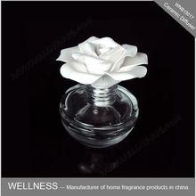 ceramic fragrance flower diffuser in glass holder