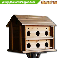 Large wooden decorated bird house