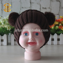 Gorrita personalizada de Navidad tejida a punto de lana para Invierno gris Skullies 2014 con sombreros lindos hechos a punto de piel de conejo a la moda Pom