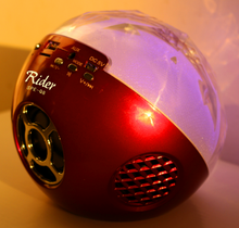 spheroidal mini Rider speakers with glint lights for music and diversity audio files