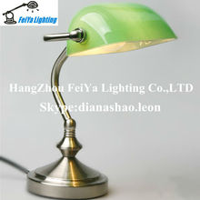 Modern green bankers lamp with glass shade