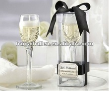 Glass cup shaped candles for wedding favors
