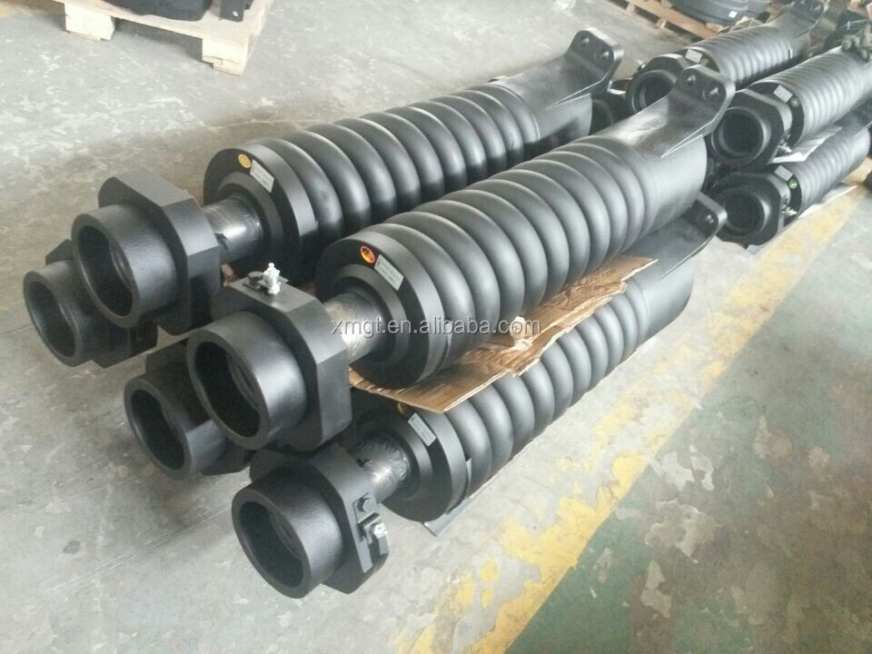 Undercarriage track spring assemblies