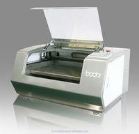 maquina de corte y de grabado por laser para textil
