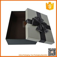 paper packaging box for gift with ribbon tied