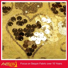 The hot sale top 100 design 100% polyester popular beautiful fascinating elegant sequin fabric post your girls