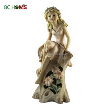 2015 New design Garden Decorations girl with garland and stump