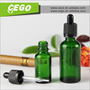 Hot sale 15ml 30ml empty green glass essential oil bottle with dropper child resistant tamper ring cap