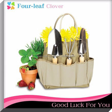 4-pc. Garden Tote & Tool Set, includes: garden tote, digging trowel, planting trowel & garden cultivator