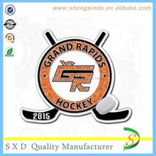 2015 brooch badge with glittering hockey sticks and Hockey ball logo