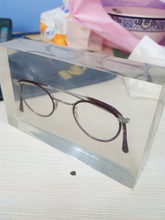 TW--33 acrylic paperweight with glasses inside