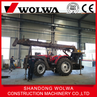 crane mounted on tractor with drill attachments on sale