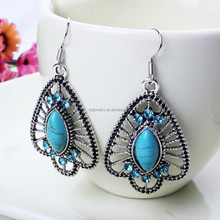 The New Alloy Hollow Exaggerated Turquoise and Diamond Earrings