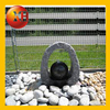 Outdoor stone wall fountain with tap