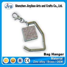 Wholesale cheap nice bag holder metal folding purse hook for wedding