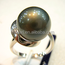 black tahitian pearl ring with gold diamond ring