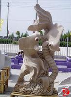 Yellow stone fish sculptures