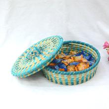 Oem environmental protection folk rattan grass handmade round storage basket