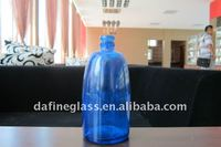spray painted blue glass wine bottle