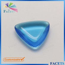 FACETS GEMS Trillion Cut Blue Topaz Glass Gemstone Cabochon