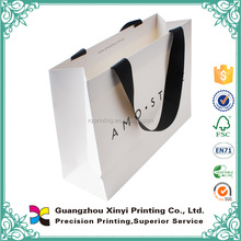 Best selling customized logo simple elegant white coated paper bag