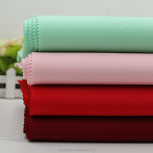 2015 fashion warp knitting fabric/95% polyester 5%spandex garment fabric textile 320gsm suit fabric