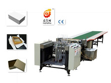 Automatic hot melt feeding and gluing machine