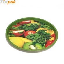 round metal tray serving fruit